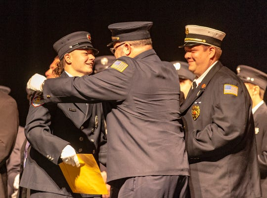 Margaret Falco of East Rutherford takes part in graduation at the Firefighter One Graduation Thursday night in Hackensack.