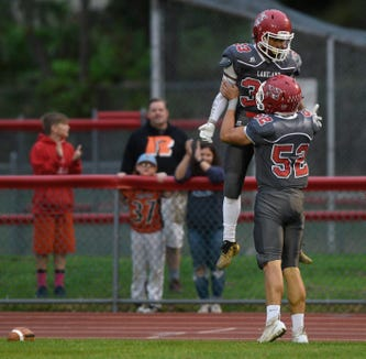 West Milford at Lakeland on Friday, September 21, 2018. L#33 Anthony Tanner celebrates with #52 JC Mertz after running for a touchdown in the first quarter.