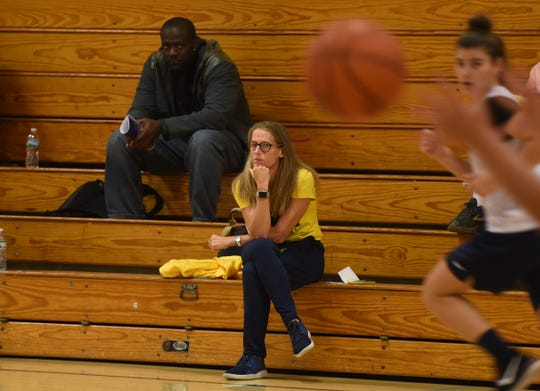 Michigan women's basketball coach Kim Barnes Arico watches Saddle River Day's Open Gym.