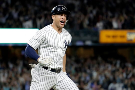 New York Yankees' Giancarlo Stanton reacts after hitting a grand slam off Boston Red Sox relief pitcher Heath Hembree during the fourth inning of a baseball game Thursday, Sept. 20, 2018, in New York.