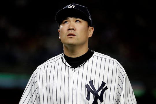 New York Yankees starting pitcher Masahiro Tanaka walks off the field after pitching the top of the fourth inning of a baseball game against the Boston Red Sox, Thursday, Sept. 20, 2018, in New York.