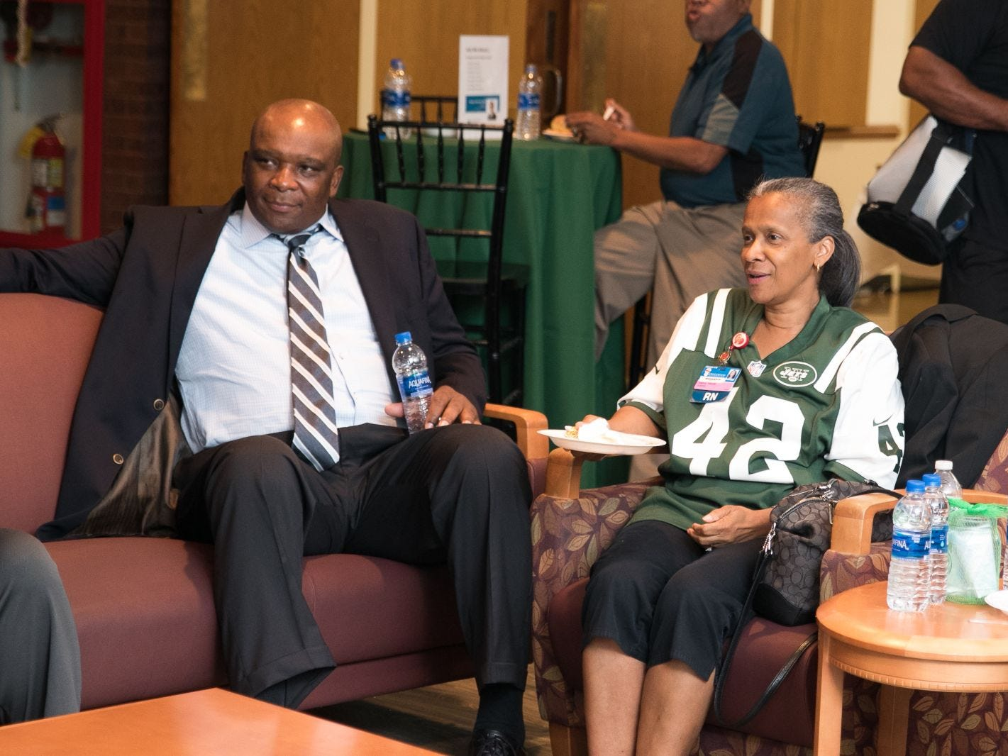 Former NY Giant Howard Cross, Nancy Harper. Englewood Health hosted its Men's Health and Football event with former Jets and Giants players and Don La Greca from ESPN radio. Attendees watched the Thursday night football game while receiving advice about staying healthy and tackling health problems early on. 09/20/2018
