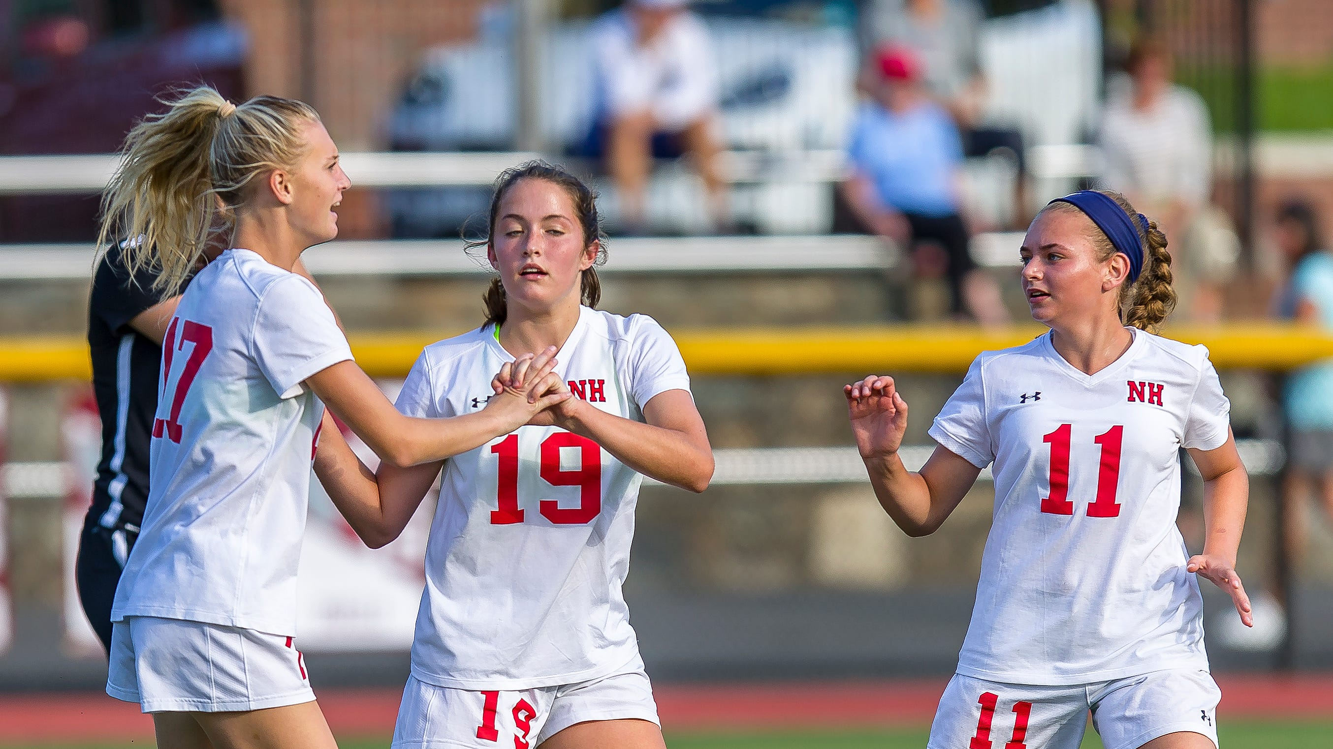 Brooke Boyer of Northern Highlands celebrates her goal with teammates Reagan Klarmann (19) and Carly Riembauer (11) during girls high school soccer action Northern Highlands plays Ridgewood.