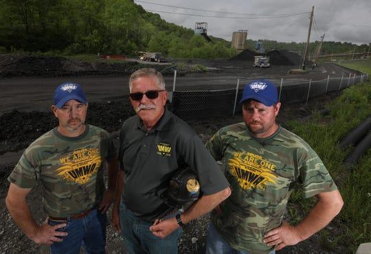 Chad Wendell, Tony Brnusak and Jim Burk on the road leading to the Cumberland Coal Mine in Waynesburg, Pennsylvania.