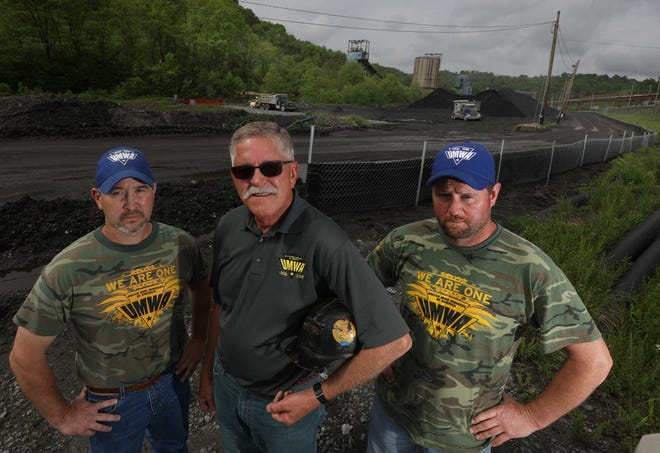 Chad Wendell, Tony Brnusak and Jim Burk on the road leading to the Cumberland Coal Mine in Waynesburg, Pennsylvania.