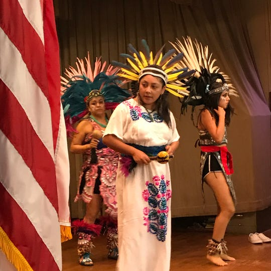 Members of Esperanza Azteca perform a traditional dance at the festivities that were part of the the renaming of Passaic's School No. 5 after Benito Juárez Thursday night.