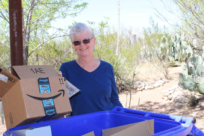 Paula Trynn, local Las Cruces resident, sorts her recycling to ensure that it's clean, dry and ready to be picked up. Remember, don't bag your recycling before it goes into the blue bin.