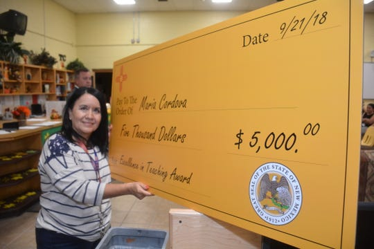 """Santa Teresa Middle School language arts teacher Maria Cordova received a $5,000 """"Excellence in Teaching"""" award from the Public Education Department on Friday, September 21, 2018. She received the award in her classroom in Santa Teresa."""
