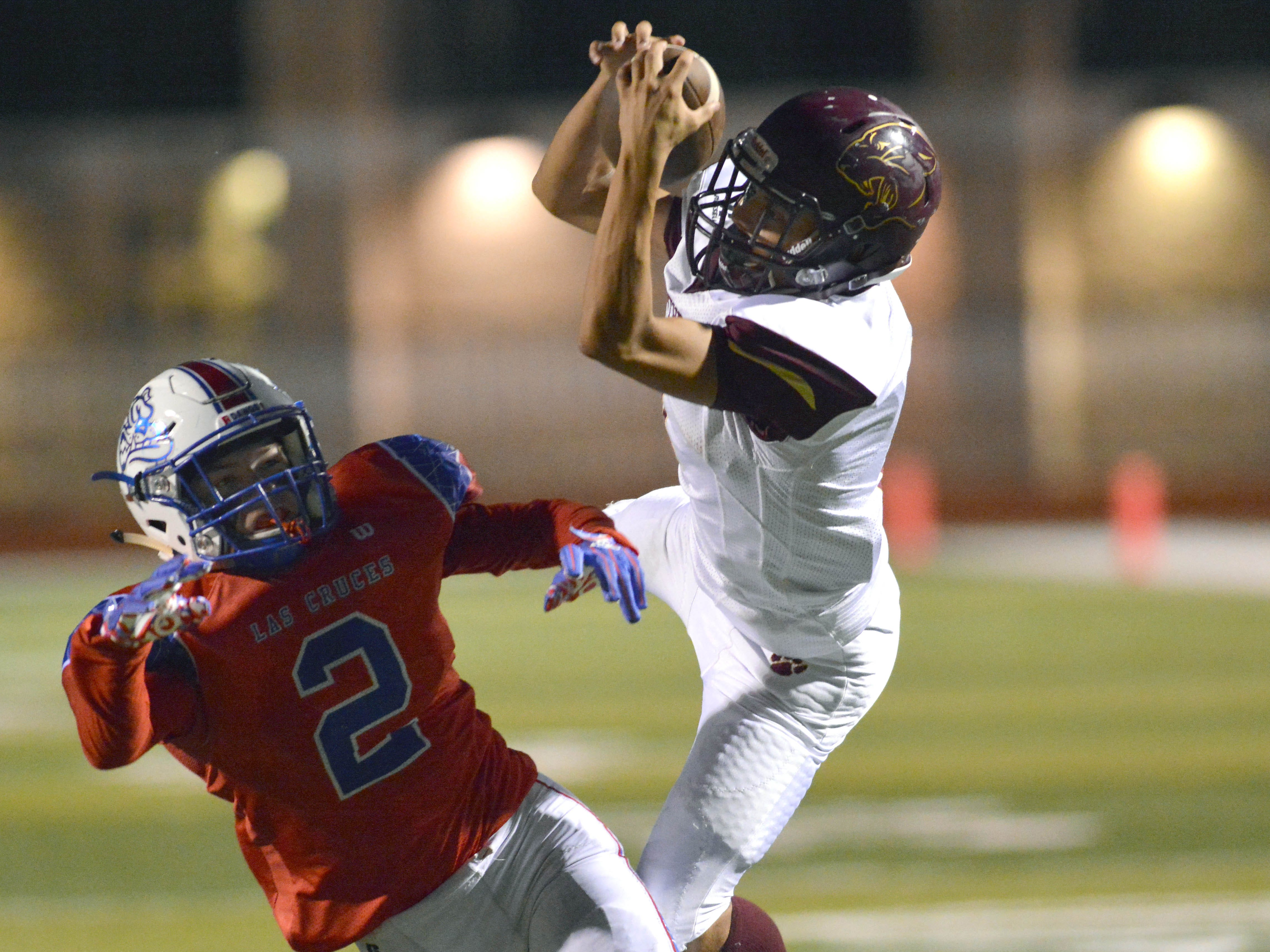 Gadsden defensive back Derrick Martinez goes up and intercepts a pass intended for Las Cruces High's Kennedy Aleman Thursday night at the Field of Dreams.
