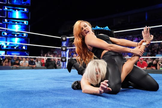 Becky Lynch puts the Dis-arm-her on Charlotte Flair. Lynch and the rest of the SmackDown Live roster return to the Pan American Center Sunday evening for WWE live event.