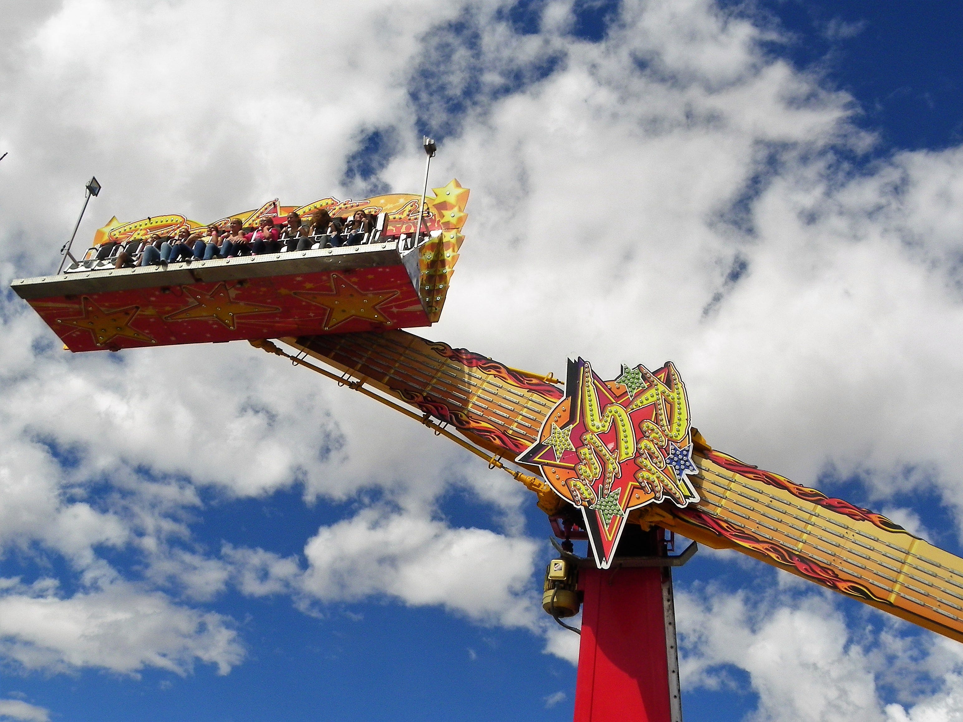 The Rock Star Ride swings above the Otero County Fair Midway Friday.