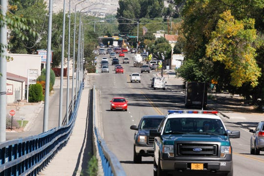 Traffic moves along Main Avenue, Thursday, Sept. 21, 2018 in downtown Aztec.