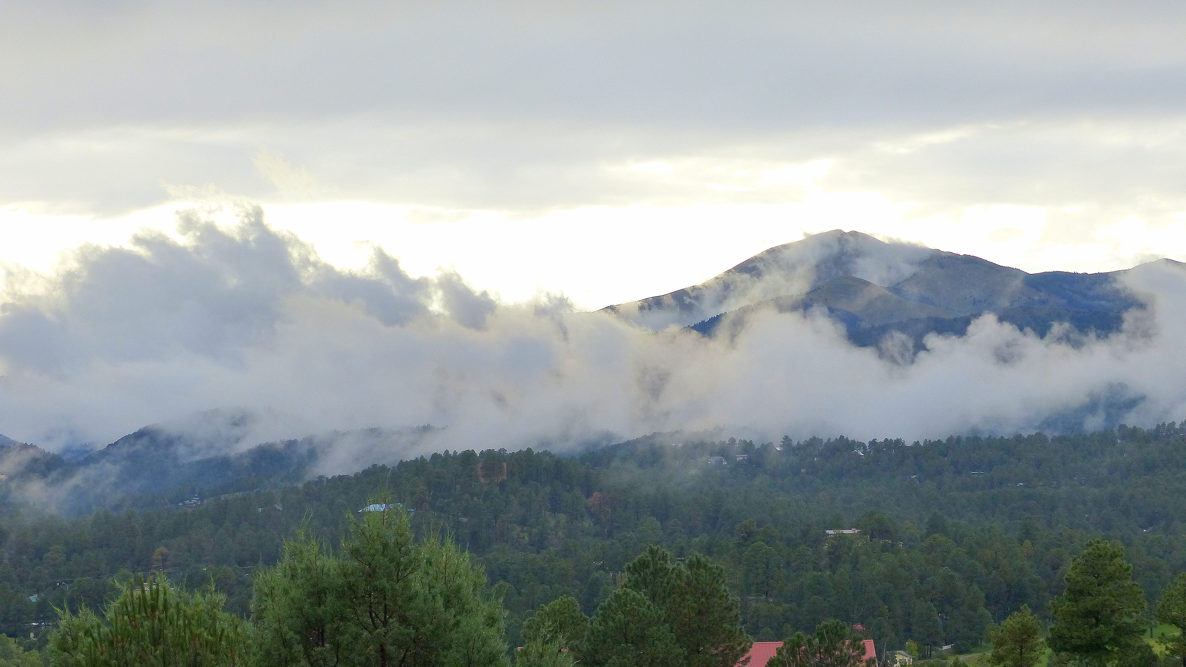 Sierra blanca Peak emerges from heavy fog that hung in the valley around Ruidoso after a round of drenching rain Thursday.