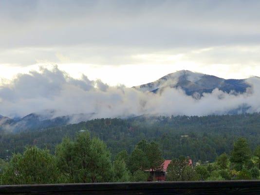 Mountain In Heavy Fog