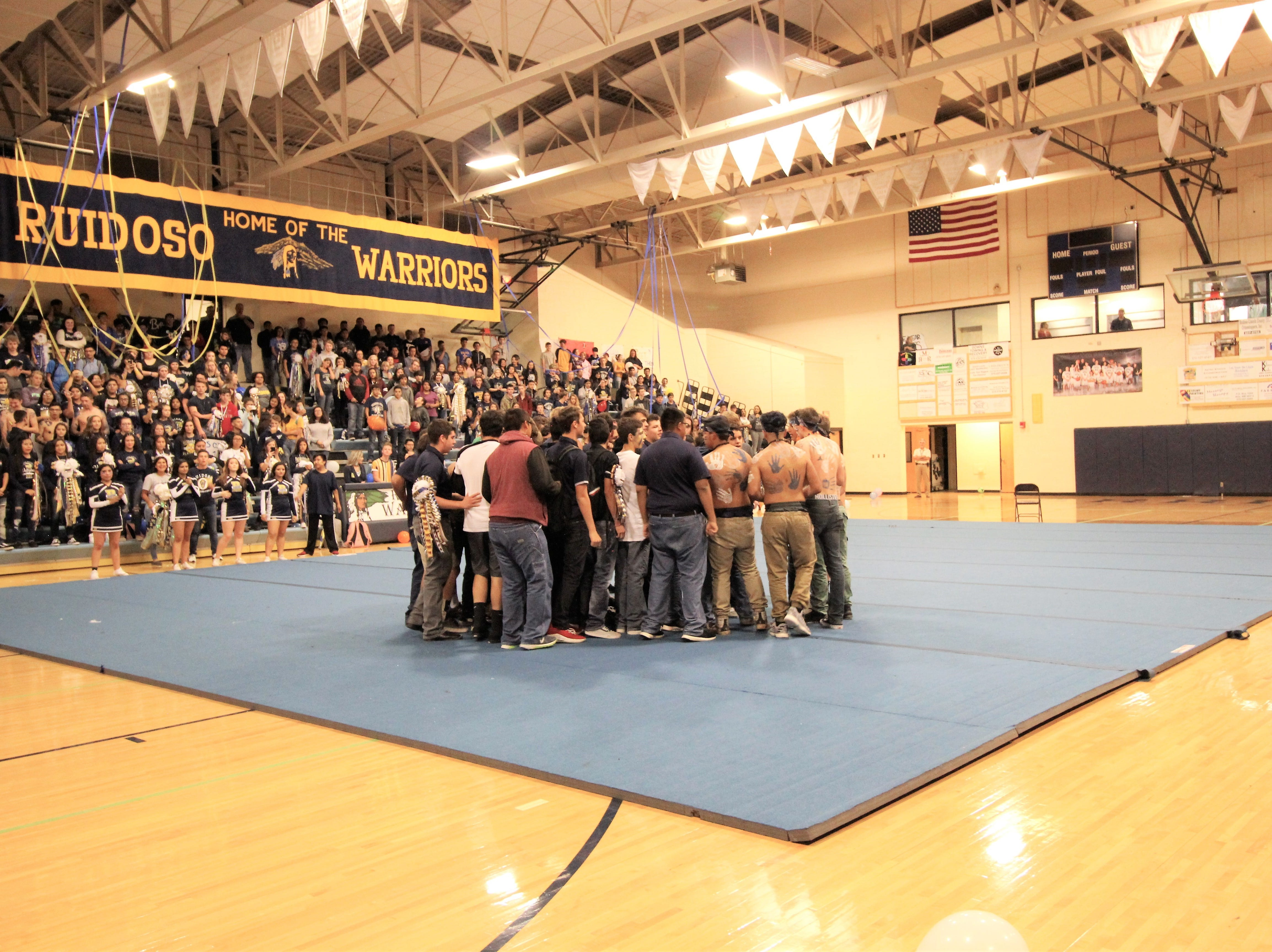 The team huddles at the 2018 Ruidoso High School pep rally chanting on the student body as they hope to beat their rivals the Tularosa Wildcats at their 2018 Homecoming game.