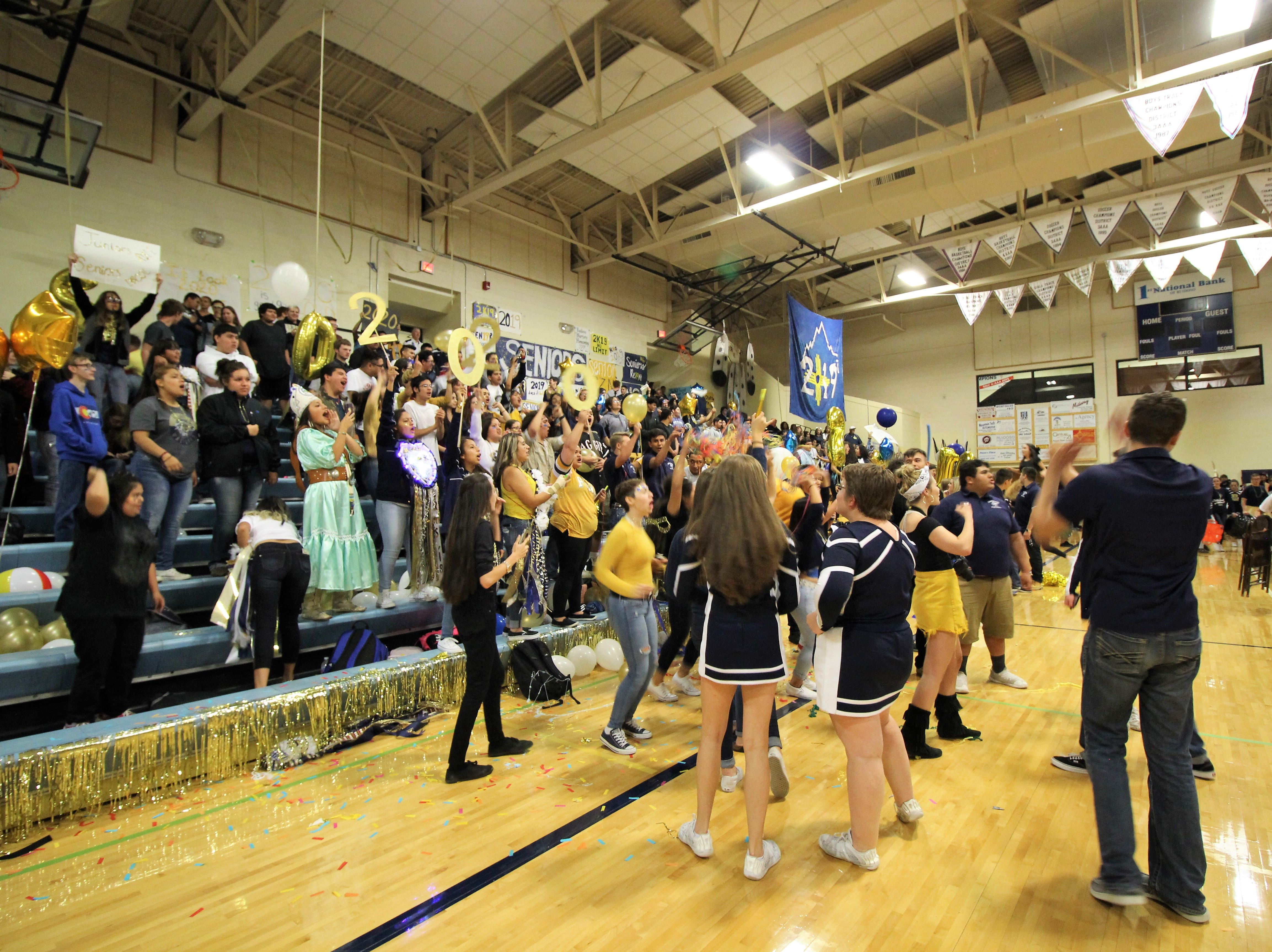 Students cheer on the Mighty Warrior at  the 2018 Homecoming pep rally.