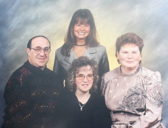 A Massa family portrait taken approximately 10 years ago. Pictured, clockwise from left, are Tony, Michelle, Linda and Andrea.