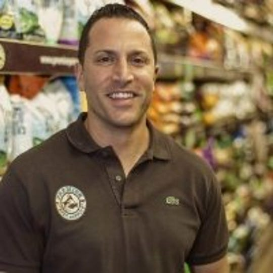 Mike Palmer, owner of Premier Pet Supply, inside one of the family stores.