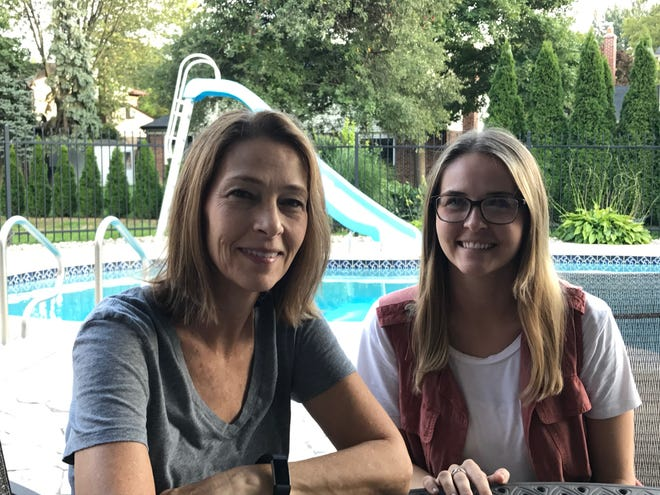 Troy's Lynda Schmitz (left) and daughter Leah Schmitz, of Rochester Hills, are longtime proponents of how community coalitions help keep young people on the path to health and happiness.