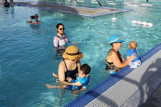 """Desert Swim Academy founder and instructor guides her """"Baby Sharks"""" class."""