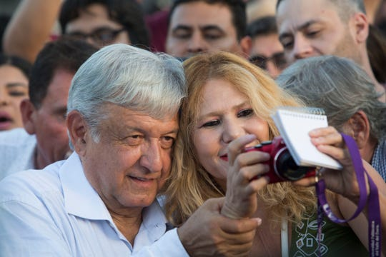 "Mexico's President-elect, Andres Manuel Lopez Obrador takes time to take selfies with his supporters as he arrives at Mexicali's Civic Center on September 20, 2018 during his ""Gratitude Tour"" to the capital of Baja California."