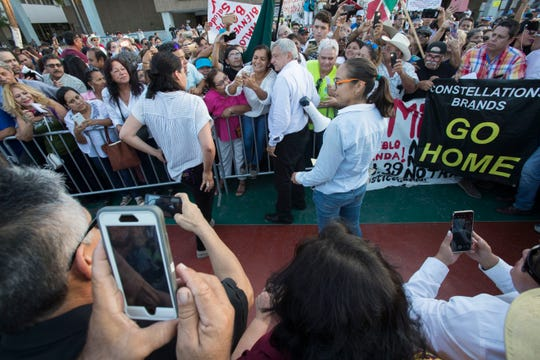 """Mexico's President-elect, Andres Manuel Lopez Obrador takes time to take selfies with his supporters as he arrives at Mexicali's Civic Center on September 20, 2018 during his """"Gratitude Tour"""" to the capital of Baja California."""