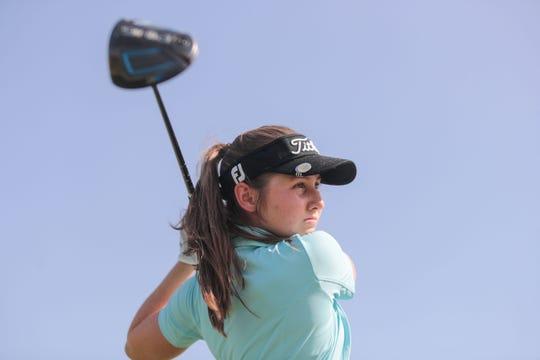 Caroline Wales, Palm Desert High School golfer, on the driving range at Desert Willow Country Club on Friday, September 21, 2018.