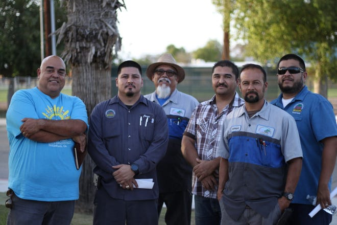 Bus drivers and mechanics stand outside Coachella Valley Unified School District's office after addressing the board on September 20, 2018 about staff shortages and aging buses.