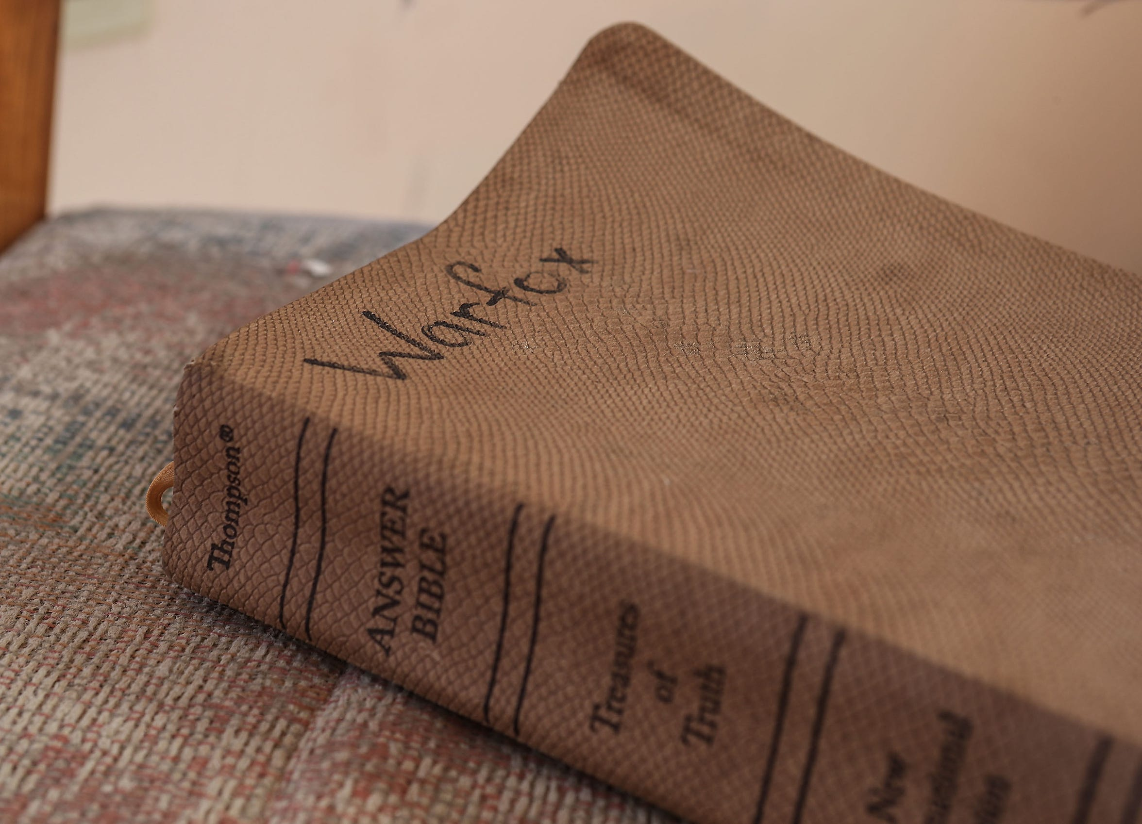 A bible with the Warfox name in an abandoned home in Landers, California where the Warfox family had been living, September 20, 2018.