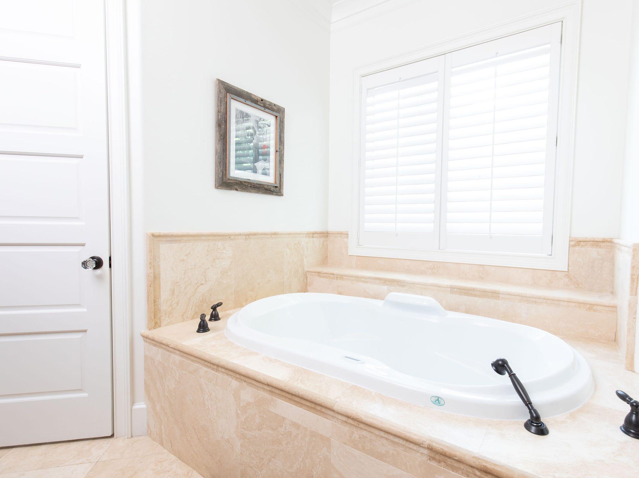 1329 Quiet Cove Court, a master bath tub.