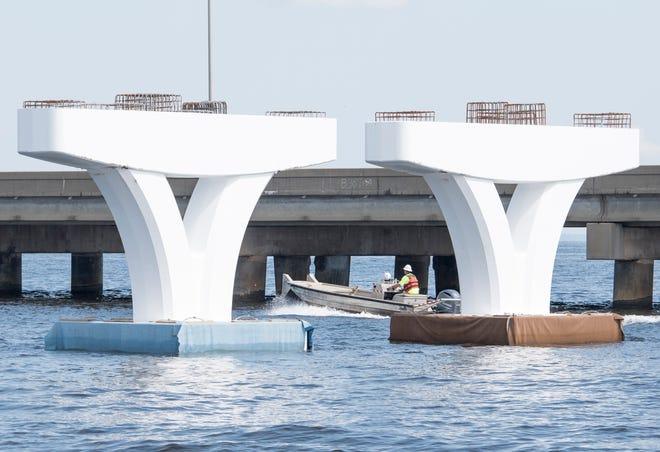 Crews work on the contruction of the new Pensacola Bay Bridge on Wednesday, September 19, 2018.