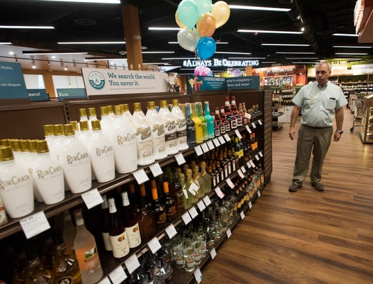 Mike Duncan, district manager of ABC Fine Wine and Spirits, shows off the selection at the company's new store on Bayou Blvd. on Friday, Sept. 21, 2018. The nearly 18,000 square foot Liquor store features a wide variety of fine wines, liquors, spirits, and beers as well as a walk-in humidor stocked with an excellent selection of cigars.