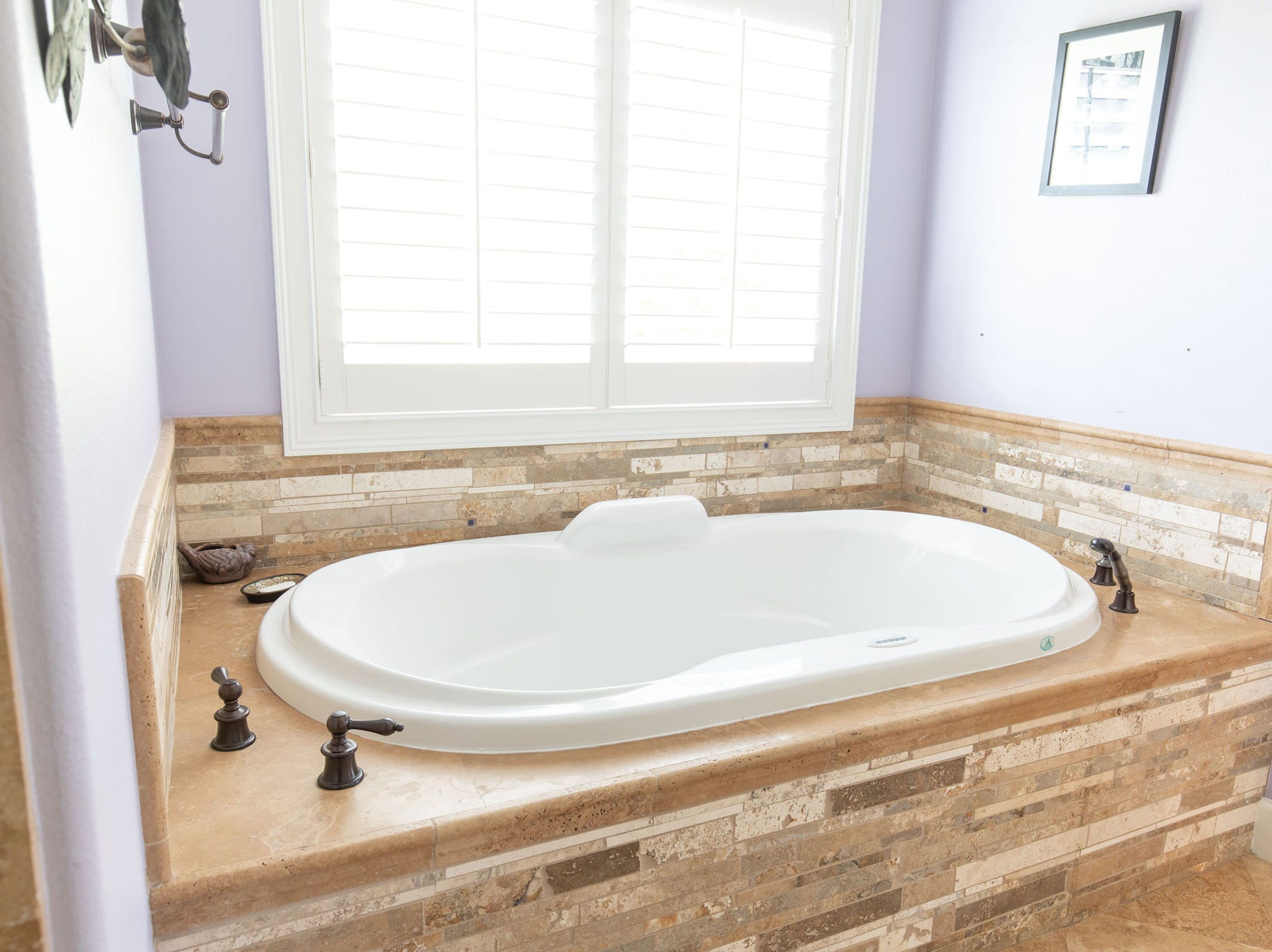 1329 Quiet Cove Court, the master tubs are perfect for relaxation.