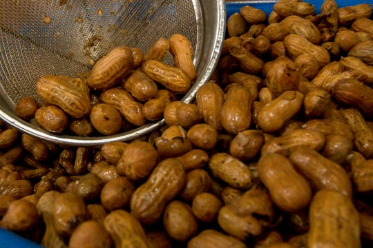 Boiled peanuts are bagged at Holland Farms on Wednesday, September 19, 2018.