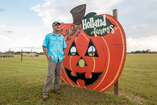 B.J. Holland, 30, manager of Holland Farms, talks about their annual Pumpkin Patch, which includes a pumpkin patch, three different corn mazes, hayrides, corn boxes, swings, a petting zoo and more on Wednesday, Sept. 19, 2018.