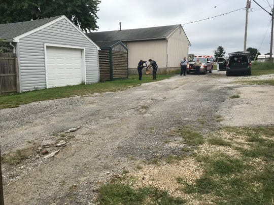 Police bag evidence in an alley in the 500 block of York Street where a stabbing victim was found on Sept. 21, 2018.