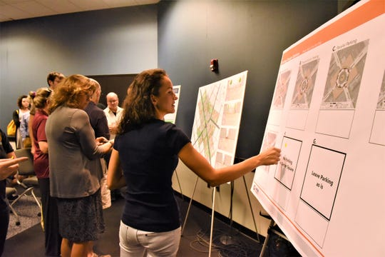 Residents put stickers on which design option they like best at the second streetscape meeting at 6 p.m. on Sept. 20 in the Guthrie Memorial Library.