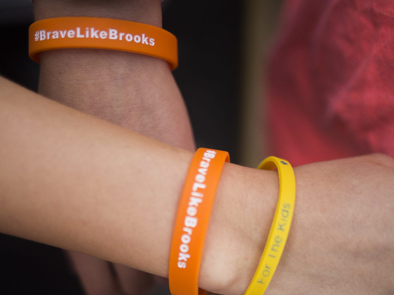 Members of the student section display bracelets honoring former Red Lion  student Brooks Argento who died earlier this week from a brain tumor after a two year battle. Red Lion plays South Western in football at Horn Field in Red Lion, Friday, September 21, 2018.