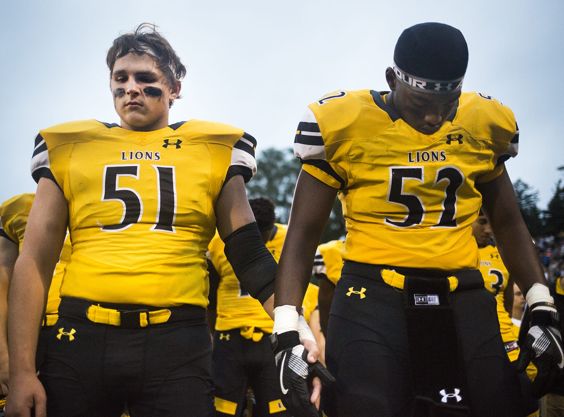 Red Lion teammates, Carter Yarish, left, and Kairen Gordon-Bey observe a moment of silence honoring former Red Land student Brooks Argento who died earlier this week from a brain tumor after a two year battle. Red Lion plays South Western in football at Horn Field in Red Lion, Friday, September 21, 2018.