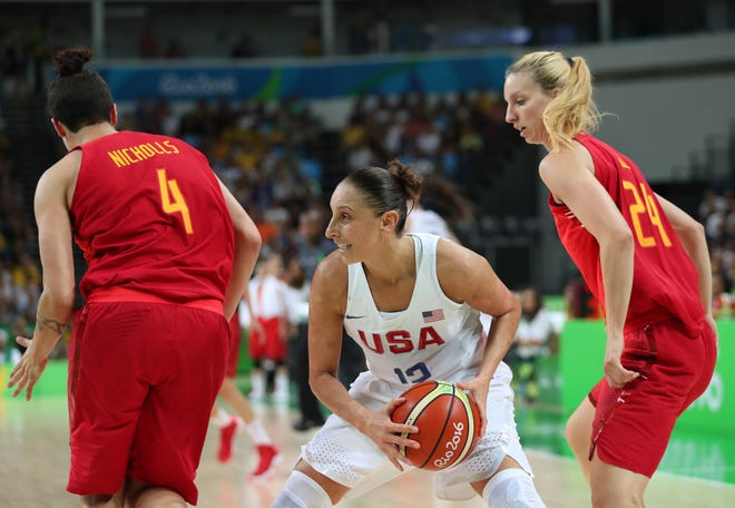 Aug 20, 2016; Rio de Janeiro, Brazil; USA guard Diana Taurasi (12) USA guard Diana Taurasi (12) protects the ball versus Spain during the women's basketball gold medal match during the Rio 2016 Summer Olympic Games at Carioca Arena 1. Mandatory Credit: Jeff Swinger-USA TODAY Sports
