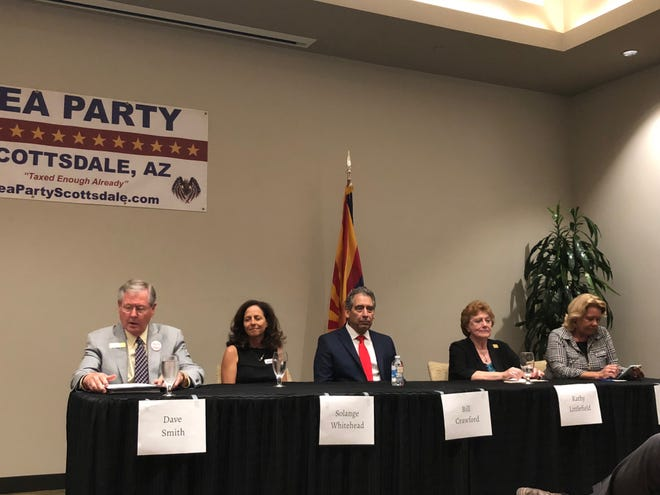 Scottsdale City Council candidates David Smith (left), Solange Whitehead, Bill Crawford, Kathy Littlefield and Linda Milhaven faced voters' questions in an open forum hosted by the Tea Party of Scottsdale.