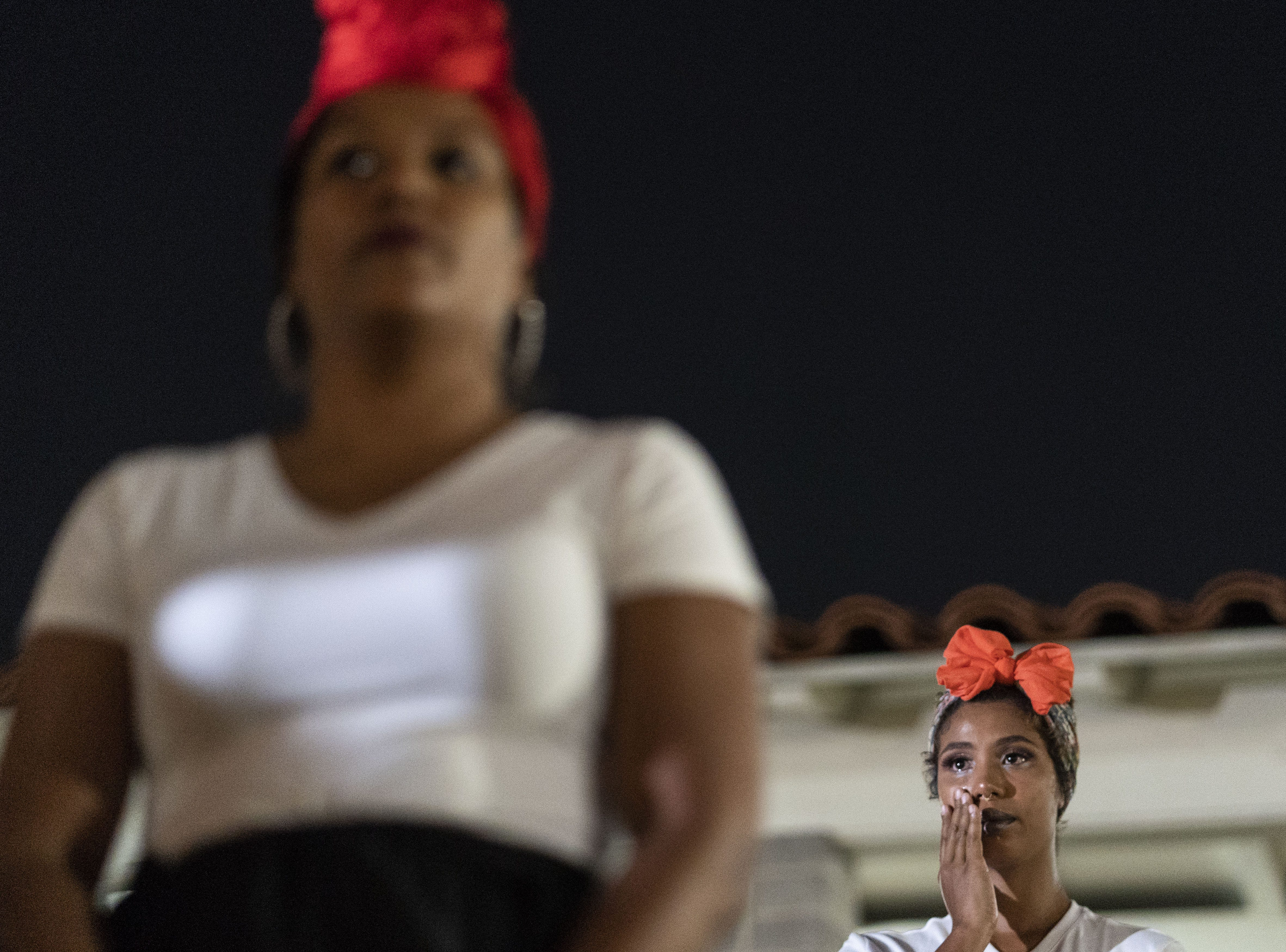 Yadeliz Ceballos, 27, from Puerto Rico, wipes away tears during the commemoration of the one-year anniversary of Hurricane Maria.