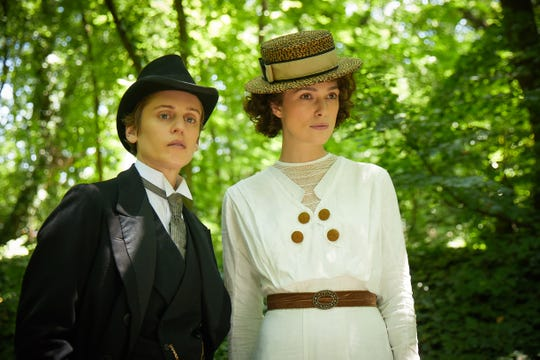 "Missy (Denise Gough, left) catches Colette's (Keira Knightley) eye in ""Colette."""