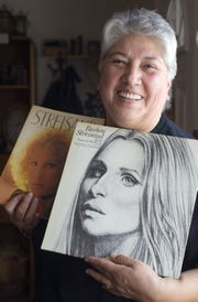 In a 2006 photo, Tina Barajas shows off some of her Barbra Streisand memorabilia.