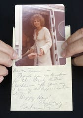 "In a 2006 photo, Tina Barajas shows her picture of Barbra Streisand snapped during the making of ""A Star Is Born,"" along with a thank-you note she later received from the star."