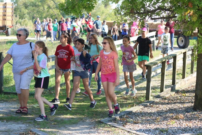 Students trekked through the Ottawa National Wildlife Refuge at the 57th annual Fifth Grade Conservation Field Day.