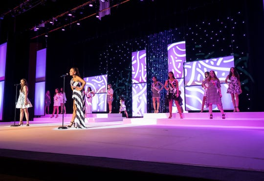 Contestants wait on-stage Friday, Sept. 21, 2018 during a dress rehearsal for the Miss Michigan Teen competition.