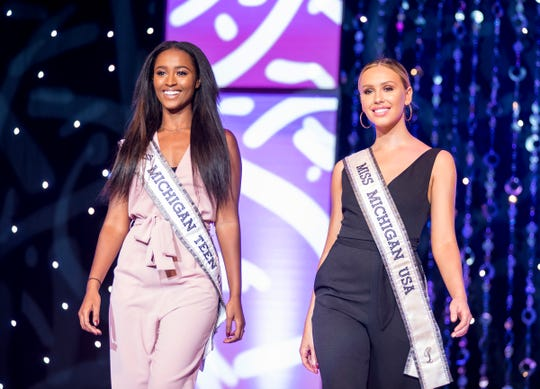 2018 Miss Michigan Teen USA Anane Loveday, left, walks on stage next to 2018 Miss Michigan USA Elizabeth Johnson Friday, Sept. 21, 2018 during a dress rehearsal for the Miss Michigan Teen competition.