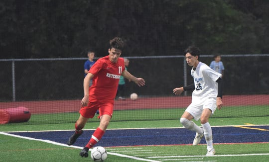Ketcham's Garrett Poorman looks to dribble around  John Jay's Dylan Galantich.