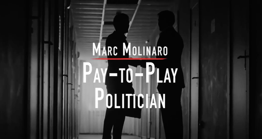 A still from a television advertisement from Gov. Andrew Cuomo's campaign accusing Marc Molinaro, his Republican opponent, of pay to play.